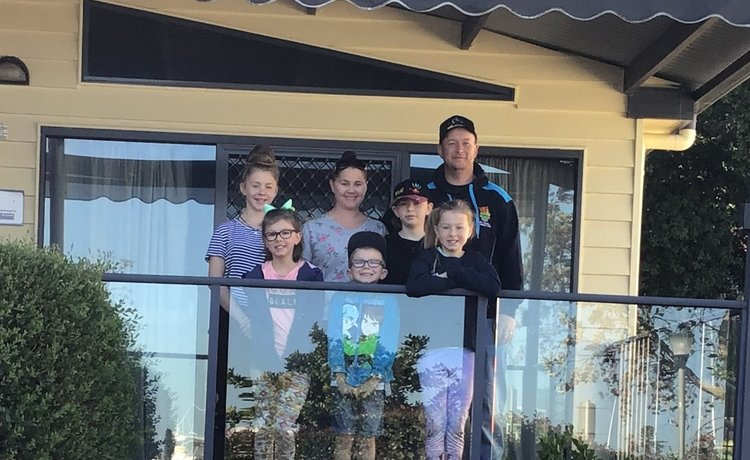 Family standing on balcony